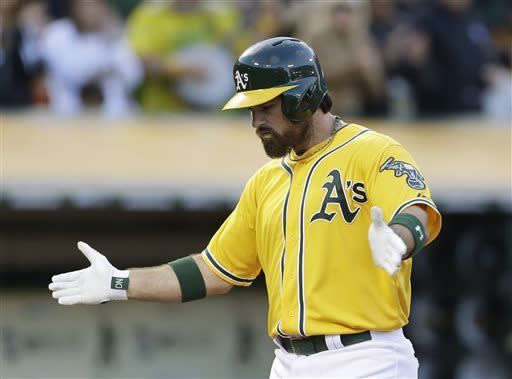 Oakland Athletics' Derek Norris reacts after hitting a two-run home run off San Francisco Giants starting pitcher Michael Kickham during the second inning of a baseball game Tuesday, May 28, 2013, in Oakland Calif. (AP Photo/Eric Risberg)