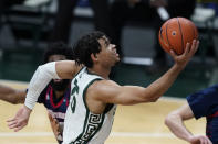 Michigan State forward Malik Hall makes a layup during the first half of the team's NCAA college basketball game against Detroit Mercy, Friday, Dec. 4, 2020, in East Lansing, Mich. (AP Photo/Carlos Osorio)