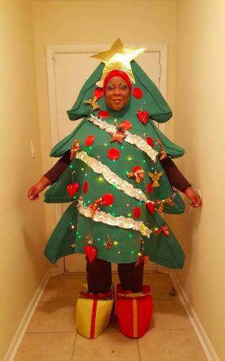 "<p>The <a href=""https://www.popsugar.com/buy/Christmas-Tree-Costume-389621?p_name=Christmas%20Tree%20Costume&retailer=amazon.com&pid=389621&price=79&evar1=moms%3Aus&evar9=45482678&evar98=https%3A%2F%2Fwww.popsugar.com%2Fphoto-gallery%2F45482678%2Fimage%2F45510524%2FChristmas-Tree-Costume-79-too-good&prop13=api&pdata=1"" rel=""nofollow"" data-shoppable-link=""1"" target=""_blank"" class=""ga-track"" data-ga-category=""Related"" data-ga-label=""https://www.amazon.com/Rasta-Imposta-Adult-Christmas-Costume/dp/B000H8MDIW/ref=asc_df_B000H8MDIW/?tag=hyprod-20&amp;linkCode=df0&amp;hvadid=312718395268&amp;hvpos=1o3&amp;hvnetw=g&amp;hvrand=14243034307071691695&amp;hvpone=&amp;hvptwo=&amp;hvqmt=&amp;hvdev=c&amp;hvdvcmdl=&amp;hvlocint=&amp;hvlocphy=9031967&amp;hvtargid=pla-525805727431&amp;psc=1"" data-ga-action=""In-Line Links"">Christmas Tree Costume</a> ($79) is too good.</p>"