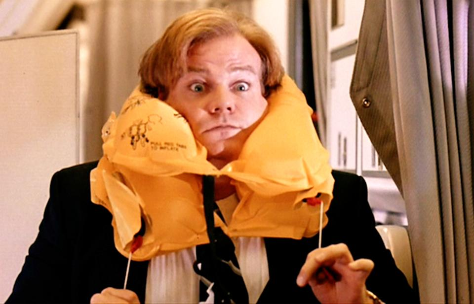 """LOS ANGELES - MARCH 31: The movie """"Tommy Boy"""", directed by Peter Segal. Seen here, Chris Farley as Tommy Callahan, impersonating as a flight attendant demonstrating a life preserver.  Initial theatrical release March 31, 1995. Screen capture. Paramount Pictures. (Photo by CBS via Getty Images)"""
