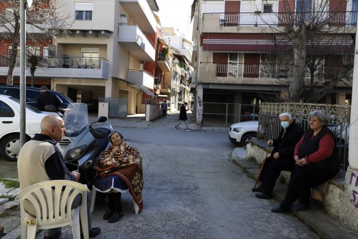 People gather outside their houses after an earthquake in Larissa city, central Greece, Wednesday, March 3, 2021. The earthquake with a preliminary magnitude of over 6.0 has struck central Greece and was felt as far away as the capitals of neighboring Albania, North Macedonia, Kosovo and Montenegro. (AP Photo/Vaggelis Kousioras)