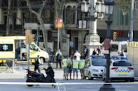 <p>Mossos d'Esquadra Police officers and emergency service workers set up a security perimeter near the site where a van crashes into pedestrians in Las Ramblas, downtown Barcelona, Spain, August 17, 2017. (Andreu Dalmau/EPA/REX/Shutterstock) </p>
