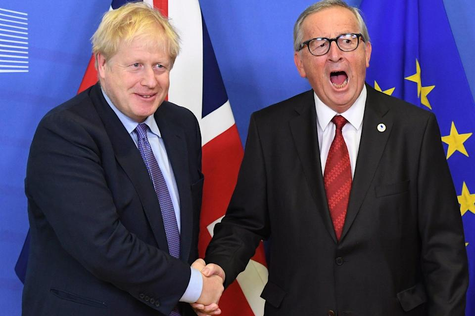 <p>Boris Johnson and Jean-Claude Juncker, President of the European Commission, ahead of the opening sessions of the European Council summit at EU headquarters in Brussels in 2019</p> (PA)