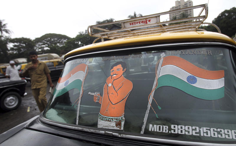 In this Tuesday, July 30, 2013, Indian flag is painted on the back windshield of a Mumbai Premier Padmini taxi, in Mumbai, India. More than 4500 Premier Padmini taxis are expected to be banned from the roads in Mumbai this year, starting in August, in line with a government order that bans cabs that are more than 20 years old. (AP Photo/Rafiq Maqbool)