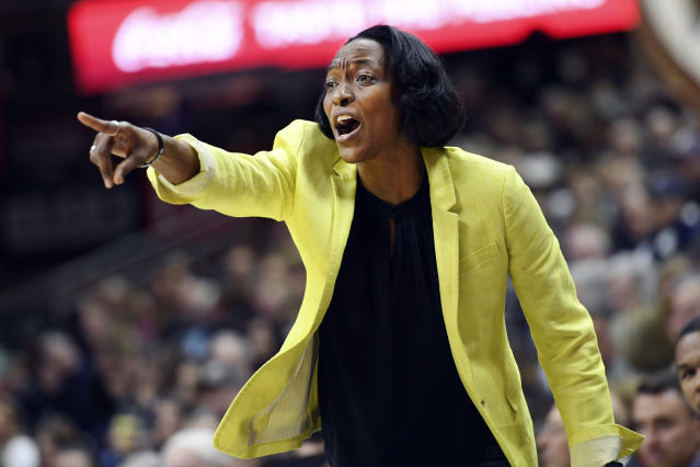 California head coach Charmin Smith directs her team during the first half of a women's NCAA college basketball game against Connecticut, Sunday, Nov. 10, 2019, in Storrs, Conn. (AP Photo/Stephen Dunn)