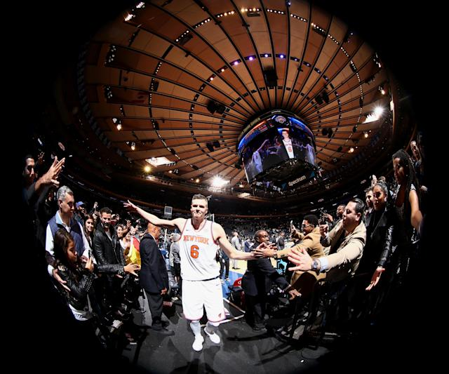 "<a class=""link rapid-noclick-resp"" href=""/nba/players/5464/"" data-ylk=""slk:Kristaps Porzingis"">Kristaps Porzingis</a> high-fives fans after the Knicks' win over the <a class=""link rapid-noclick-resp"" href=""/nba/teams/den/"" data-ylk=""slk:Denver Nuggets"">Denver Nuggets</a> on Oct. 30, 2017. (Nathaniel S. Butler/NBAE/Getty Images)"