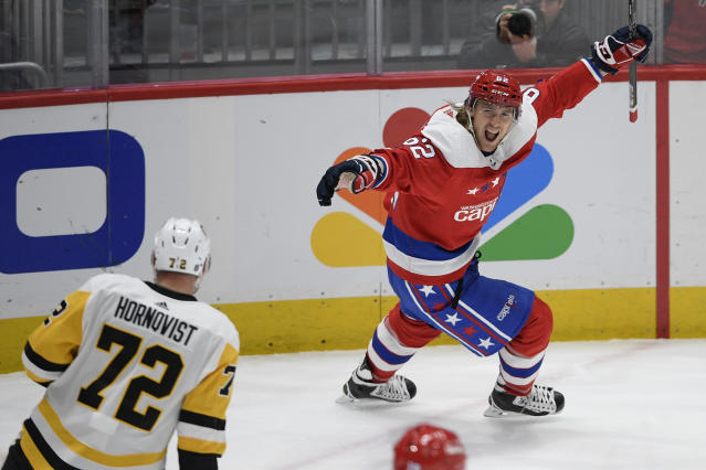 Washington Capitals left wing Carl Hagelin (62), of Sweden, celebrates his empty-net goal next to Pittsburgh Penguins right wing Patric Hornqvist (72), also of Sweden, during the third period of an NHL hockey game, Sunday, Feb. 23, 2020, in Washington. (AP Photo/Nick Wass)