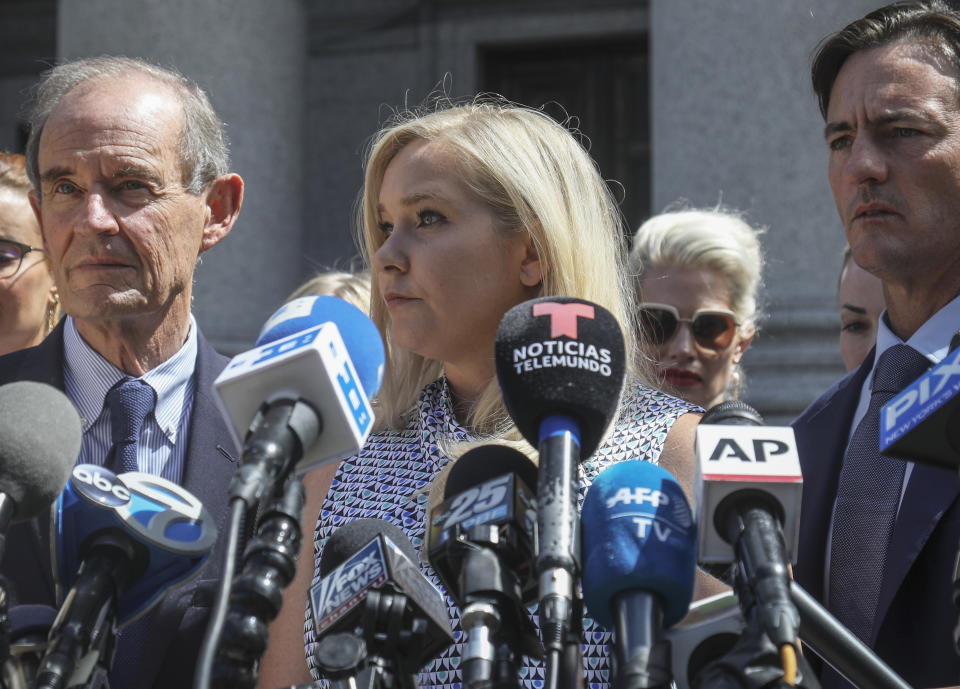 FILE - In this Aug. 27, 2019 file photo, Virginia Giuffre, center, who says she was trafficked by sex offender Jeffrey Epstein, holds a news conference outside a Manhattan court in New York. On Monday, Aug. 9, 2021, Giuffre sued Prince Andrew saying he sexually assaulted her when she was 17. Lawyers for Giuffre filed the lawsuit in Manhattan federal court. (AP Photo/Bebeto Matthews, File)