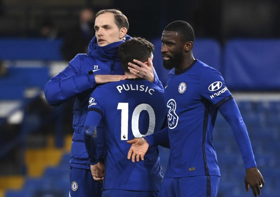 Chelsea's head coach Thomas Tuchel, left, Chelsea's Christian Pulisic, centre, and Chelsea's Antonio Rudiger react after the English Premier League soccer match between Chelsea and Manchester United at Stamford Bridge Stadium in London, England, Sunday, Feb. 28, 2021. (Andy Rain/Pool via AP)
