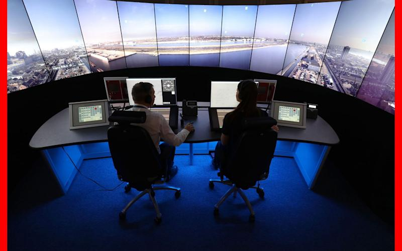 NATS personnel give a demonstration in the operations room at National Air Traffic Services (NATS) Swanwick in Hampshire, which will direct aircraft at London City Airport using the UK's first remote digital air traffic control tower - PA