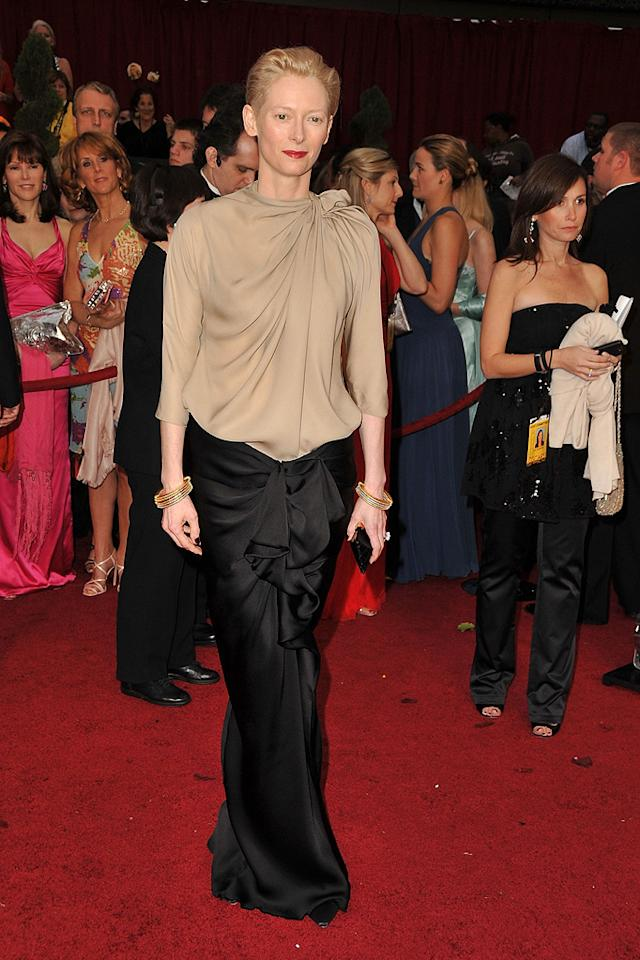 Tilda Swinton   Grade: C-       Last year's Best Supporting Actress winner caused a commotion in yet another questionable ensemble which consisted of a beige Lanvin blouse and black satin skirt.