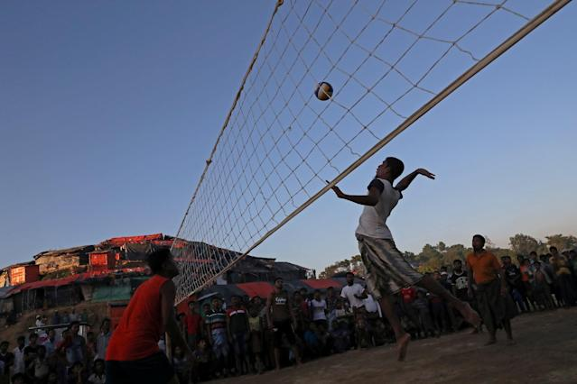 REFILE - CORRECTING NAME OF DISCIPLINE Rohingya refugees play volleyball in a makeshift refugee camp in Cox's Bazar, Bangladesh November 8, 2017. REUTERS/Mohammad Ponir Hossain
