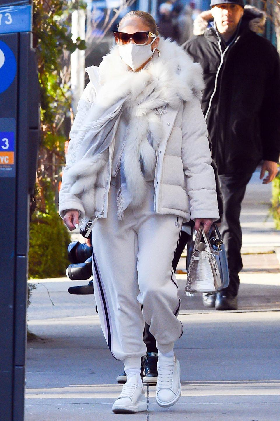<p>Jennifer Lopez matches her mask to her ensemble on Tuesday in N.Y.C.</p>