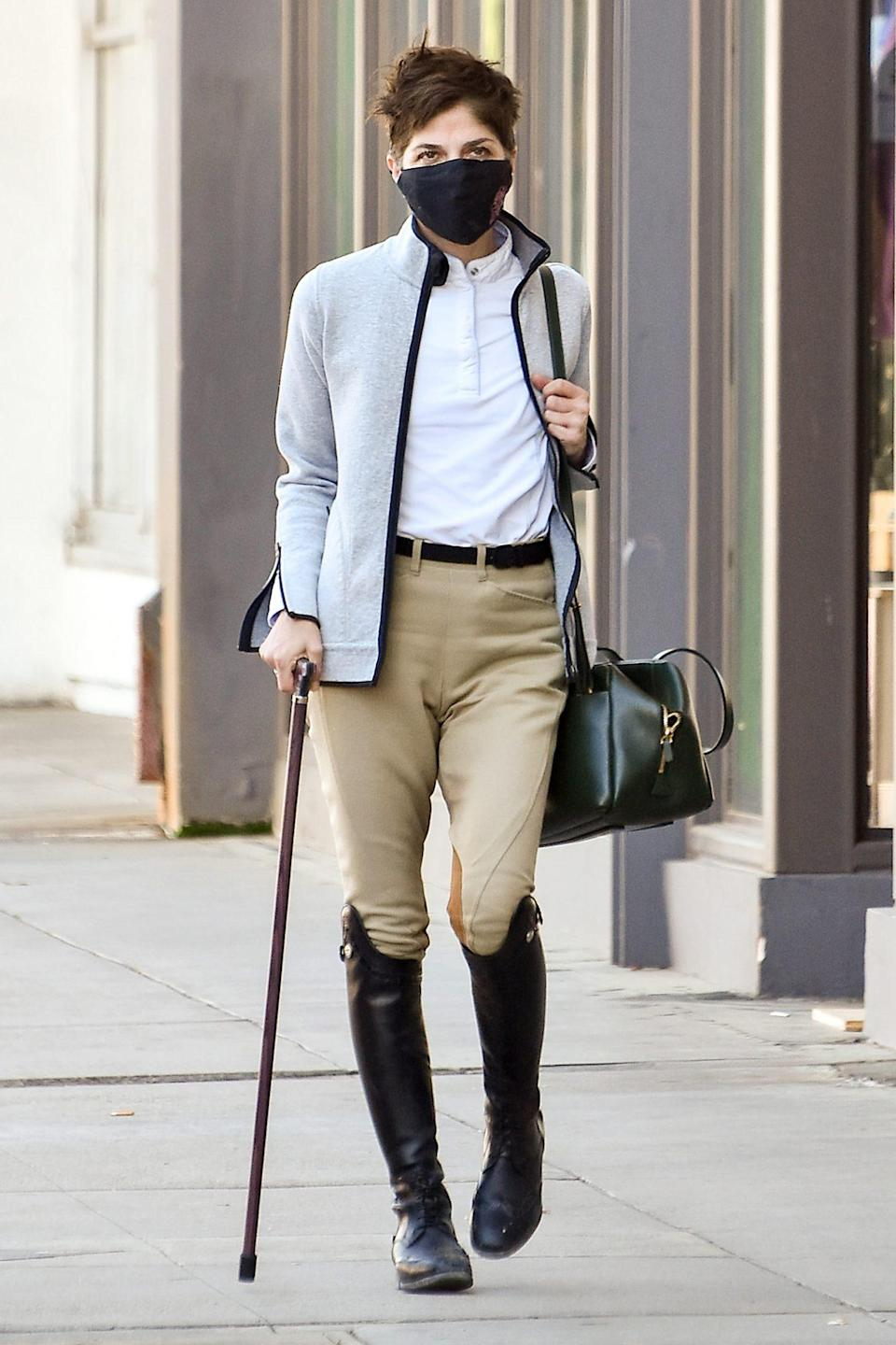 <p>Selma Blair steps out in a stylish white top and tan trousers with black knee high boots on Thursday in L.A.</p>