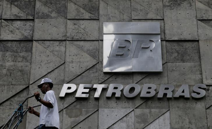 A man walks past the Brazil's state-run Petrobras oil company headquarters in Rio de Janeiro