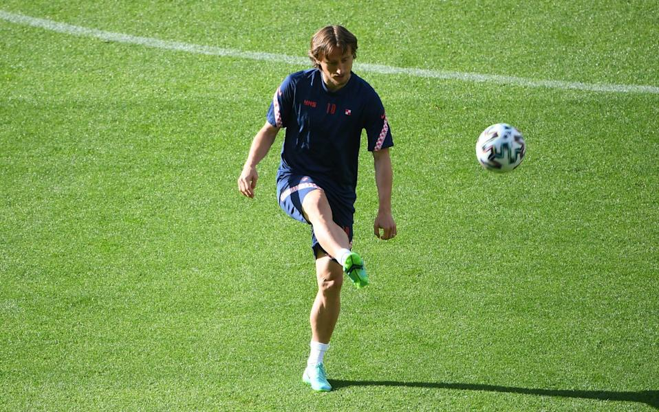 Luka Modric of Croatia controls the ball as he warms up during the Croatia Training Session ahead of the UEFA Euro 2020 Group D match between Croatia and Czech Republic at Hampden Park on June 17, 2021 in Glasgow, Scotland - Andy Buchanan - Pool/Getty Images