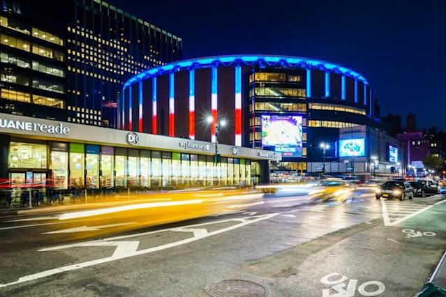 shutterstock_566171293 Madison Square Garden, New York, USA Illuminated stadium with car riding around city, cityscape, architecture, .