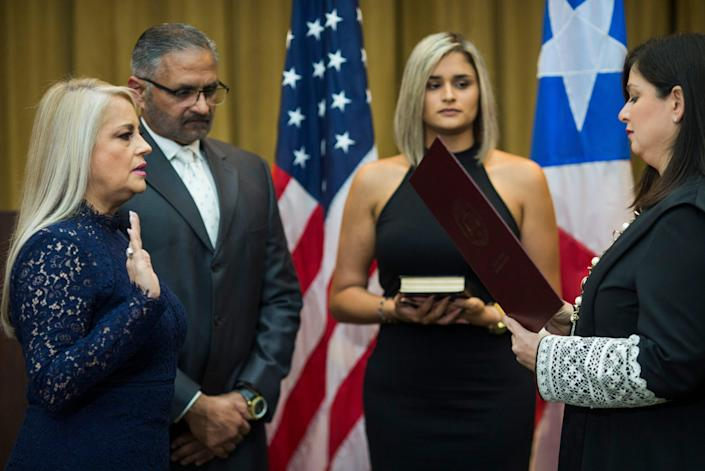 Justice Secretary Wanda Vazquez is sworn in as governor of Puerto Rico by Supreme Court Justice Maite Oronoz, in San Juan, Puerto Rico, on Aug. 7. Vazquez took the oath of office after the Puerto Rican Supreme Court ruled that Pedro Pierluisi's swearing in on Aug. 2 was invalid.