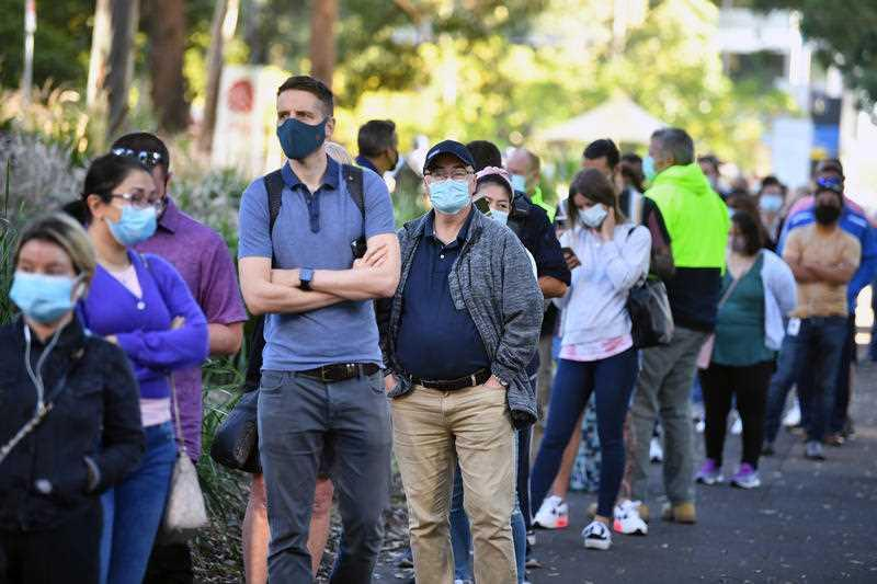 A queue forms outside at a mass Covid-19 vaccination hub in Sydney.