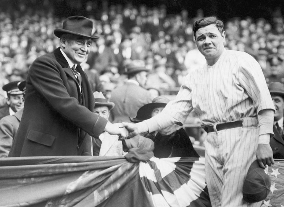 President Warren G. Harding shakes hands with New York Yankee player Babe Ruth.