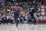 FILE - Washington Wizards' Will Bynum brings the ball up against the Cleveland Cavaliers in an NBA basketball game in Cleveland, in this Wednesday, April 15, 2015, file photo. Eighteen former NBA players, including Bynum, have been indicted on charges alleging they defrauded the league's health and welfare benefit plan out of about $4 million, according to an indictment Thursday, Oct. 7, 2021. (AP Photo/Mark Duncan, File)