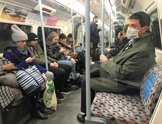 A man on the London Underground's Jubilee line of the London Underground tube network wears a protective facemask. (PA Images)