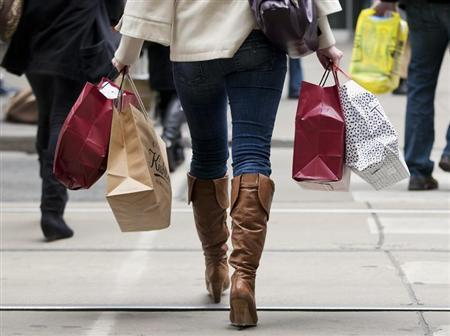 A woman carries shopping bags during the Christmas shopping season in Toronto