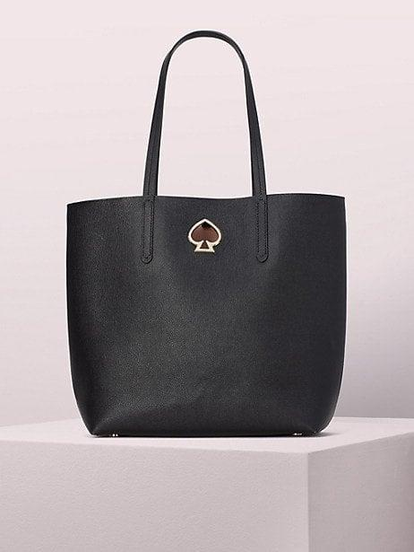 """<p>This <a href=""""https://www.popsugar.com/buy/Kate-Spade-New-York-Suzy-Large-North-South-Tote-486737?p_name=Kate%20Spade%20New%20York%20Suzy%20Large%20North%20South%20Tote&retailer=katespade.com&pid=486737&price=146&evar1=fab%3Aus&evar9=46206453&evar98=https%3A%2F%2Fwww.popsugar.com%2Fphoto-gallery%2F46206453%2Fimage%2F46571595%2FKate-Spade-New-York-Suzy-Large-North-South-Tote&list1=shopping%2Cfall%20fashion%2Cbags%2Csale%20shopping%2Ckate%20spade%20new%20york&prop13=api&pdata=1"""" rel=""""nofollow"""" data-shoppable-link=""""1"""" target=""""_blank"""" class=""""ga-track"""" data-ga-category=""""Related"""" data-ga-label=""""https://www.katespade.com/products/suzy-large-north-south-tote/PXRUA398-1.html"""" data-ga-action=""""In-Line Links"""">Kate Spade New York Suzy Large North South Tote</a> ($146, originally $298) is great for commuters.</p>"""