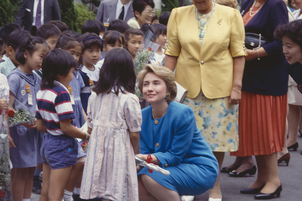 <p>Jill M. Dougherty captured this sweet moment between then-First Lady Hillary Clinton and school children in 1994. </p>