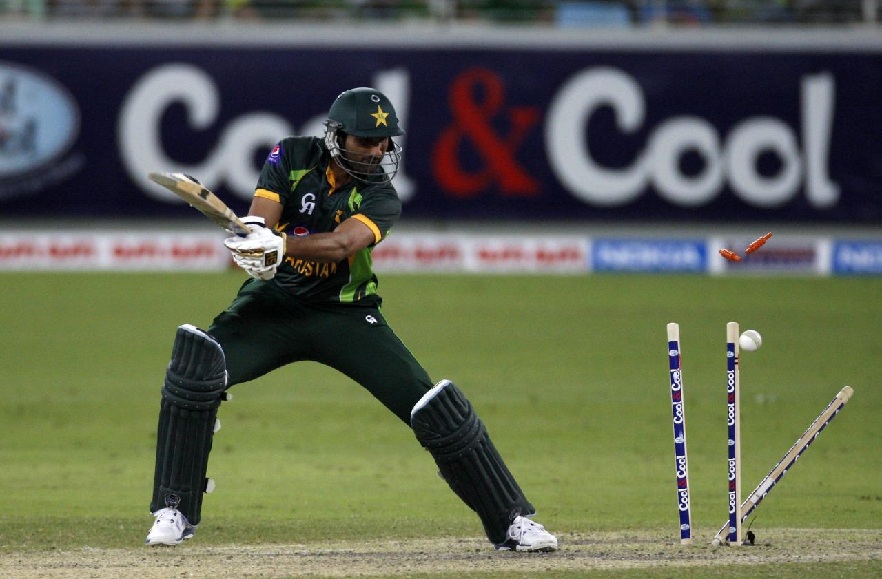 Pakistan's Sohail Tanvir is bowled during their second Twenty20 international cricket match against South Africa in Dubai November 15, 2013. REUTERS/Nikhil Monteiro (UNITED ARAB EMIRATES - Tags: SPORT CRICKET)