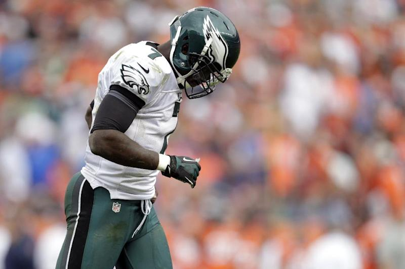 Philadelphia Eagles quarterback Michael Vick hangs his head as he leaves he field against the Denver Broncos during third quarter of an NFL football game, Sunday, Sept. 29, 2013, in Denver. (AP Photo/Joe Mahoney)