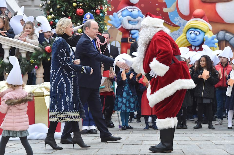 MONACO, MONACO - DECEMBER 18: Princess Charlene of Monaco and  Prince Albert II of Monaco attend the Christmas Gifts Distribution At Monaco Palace on December 18, 2019 in Monaco, Monaco. (Photo by Stephane Cardinale - Corbis/Corbis via Getty Images)