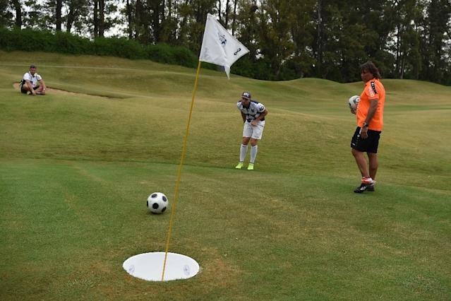 A participant from France (C) eyes the ball during the second edition of the Footgolf World Cup at Pilar Golf and Country Club near Buenos Aires on January 10, 2016 (AFP Photo/Eitan Abramovich)