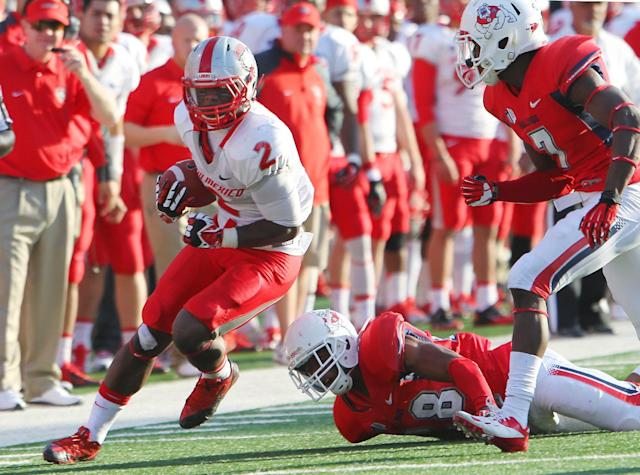 New Mexico's Crusoe Gongbay (2) runs for a first down against Fresno State in the second half of an NCAA college football game in Fresno, Calif., Saturday, Nov. 23, 2013. (AP Photo/Gary Kazanjian)
