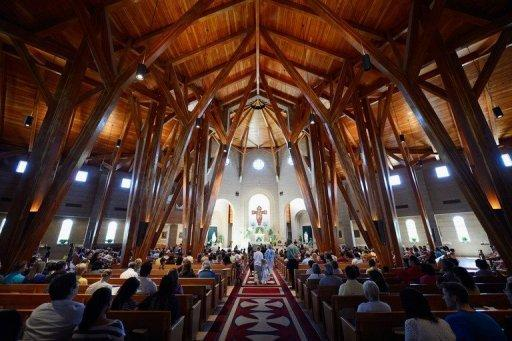 Parishioners at Our Lady of Loreto Catholic Church pray during morning mass remembering victims of the theater shooting in Aurora, Colorado. US President Barack Obama headed to Colorado on Sunday to meet victims of the cinema shooting massacre