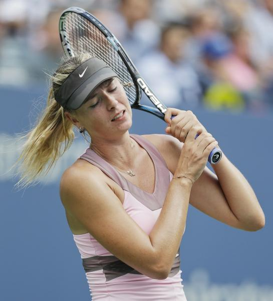 Maria Sharapova, of Russia, reacts during her match against Victoria Azarenka, of Belarus, during a semifinal match at the 2012 US Open tennis tournament, Friday, Sept. 7, 2012, in New York. (AP Photo/Darron Cummings)