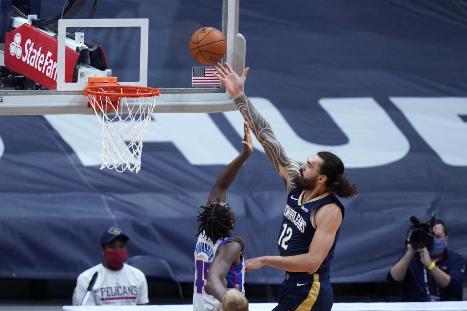 New Orleans Pelicans center Steven Adams (12) goes to the basket against Detroit Pistons forward Sekou Doumbouya (45) during the first half of an NBA basketball game in New Orleans, Wednesday, Feb. 24, 2021. (AP Photo/Gerald Herbert)