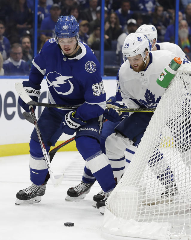 Tampa Bay Lightning defenseman Mikhail Sergachev (98) battles with Toronto Maple Leafs right wing William Nylander (29) for a loose puck behind the net during the third period of an NHL hockey game, Thursday, Jan. 17, 2019, in Tampa, Fla. (AP Photo/Chris O'Meara)