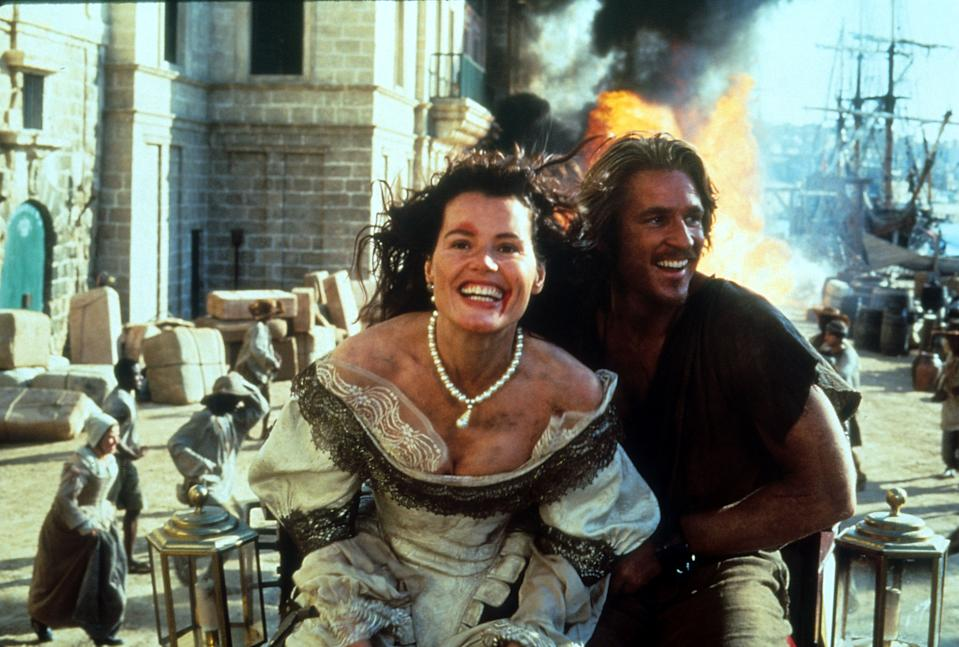 Geena Davis and Matthew Modine with ash and dirt on their bodies in a scene from the film 'Cutthroat Island', 1995. (Photo by Beckner/Gorman Productions/Getty Images)