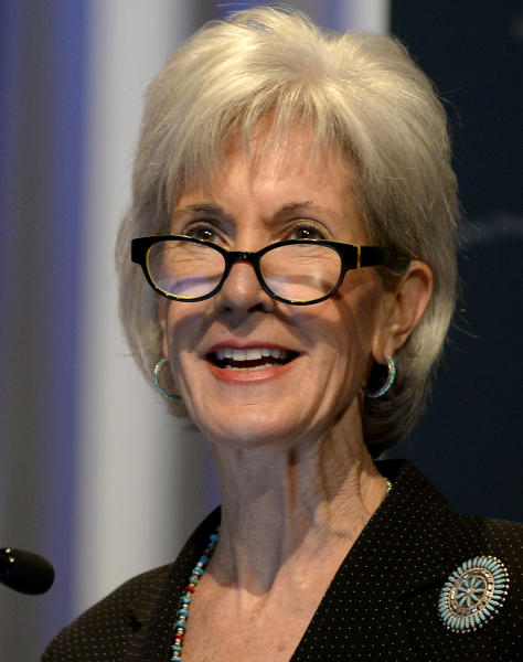 Department of Health and Human Services Secretary Kathleen Sebelius announces easier access to mental health care during Former First Lady Rosalynn Carter's 29th annual mental health policy symposium at the Carter Center on Friday, Nov. 8, 2013, in Atlanta. (AP Photo/David Tulis)