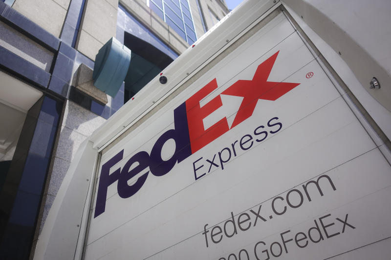 A FedEx delivery truck parks on the street, Tuesday, June 25, 2019, in downtown Cincinnati. (AP Photo/John Minchillo)