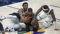 Sacramento Kings forward Maurice Harkless, center, battle for the ball against Utah Jazz's Donovan Mitchell, left, and Royce O'Neale (23) in the first half during an NBA basketball game Saturday, April 10, 2021, in Salt Lake City. (AP Photo/Rick Bowmer)