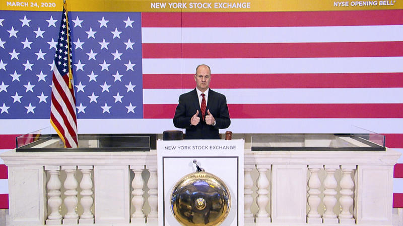 In this photo provided by the New York Stock Exchange, Chief Security Officer Kevin Fitzgibbons rings the opening bell of the NYSE on Tuesday, March 24, 2020. Stocks around the world rallied Tuesday amid expectations that Congress is nearing a deal to pump nearly $2 trillion of aid into the coronavirus-ravaged economy. (New York Stock Exchange via AP)