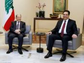 FILE PHOTO: Designated Prime Minister Hassan Diab meets with Lebanon's President Michel Aoun at the presidential palace in Baabda