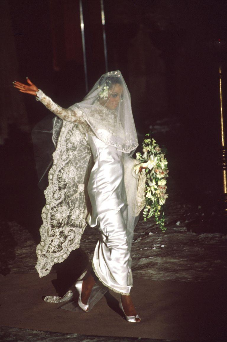 <p>Turn to the ultimate style icons of decades past, and what they wore down the aisle, for inspiration. Choose fashion's best bridal hits—like Diana Ross (pictured here), Marilyn Monroe, Audrey Hepburn, Bianca Jagger (pictured above), Elizabeth Taylor, Priscilla Presley, and more for ideas on styling your (present-day) vintage bridal look. </p><p>Whether you take notes from Ross' all-lace veil and midi length or choose a hat that nods to Jagger's iconic chapeau, tapping the fashion hits of decades past (especially those from the decade your gown is originally from) will give you ample inspiration to include vintage fashion in an equally iconic way.</p>