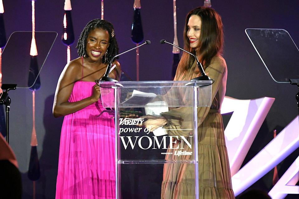 Amanda Gorman accepts an award from Angelina Jolie onstage during Variety's Power of Women