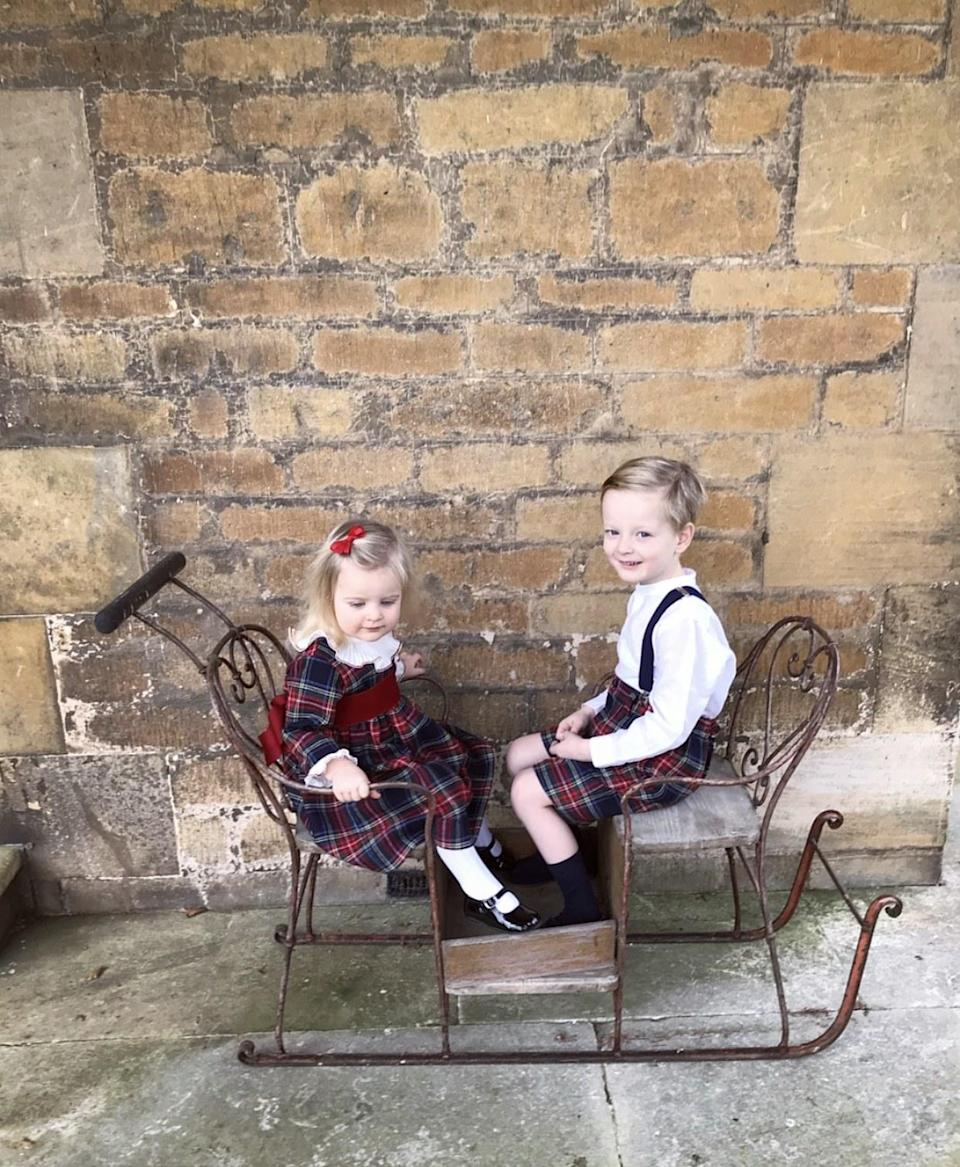 The little ones in their Amaia Christmas outfits on our sleigh.
