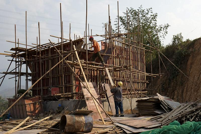 This picture taken on February 8, 2020 shows Chinese workers building the first rail line linking China to Laos, a key part of Beijing's 'Belt and Road' project across the Mekong, in Luang Prabang. - From an artificial island in Sri Lanka to a bridge in Bangladesh and hydropower projects in Nepal and Indonesia, China's trillion-dollar Belt and Road plan is stuttering under the effects of the deadly coronavirus. (Photo by Aidan JONES / AFP) / TO GO WITH Health-virus-diplomacy-trade-China-SAsia, FOCUS by Poornima WEERASEKARA and Safiqul ALAM (Photo by AIDAN JONES/AFP via Getty Images)