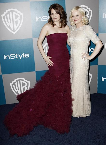 """FILE - In this Jan. 15, 2012 file photo, Tina Fey, left, and Amy Poehler arrive at the 2012 Warner Bros. and InStyle Golden Globe After Party at the Beverly Hilton in Los Angeles. Tina Fey and Amy Poehler are ready to crack each other up at the Golden Globe Awards on Sunday, Jan. 13, 2013. The two multi-hyphenate talents offered a taste of their quick-witted banter during a conference call with reporters Wednesday, Jan. 9, during which Fey promised, """"We're going to sing the whole show."""" (AP Photo/Matt Sayles, File)"""