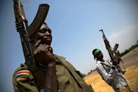 Members of the South Sudanese army (SPLA) patrol the half-emptied village of Leer, South Sudan, on February 3, 2016